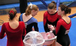 gymnastic girls chalking the hands
